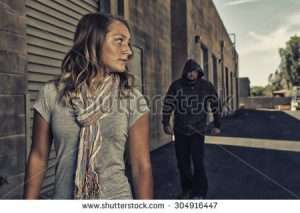 stock-photo-girl-self-defense-a-young-woman-sees-a-suspicious-person-walking-behind-her-and-plans-to-defend-304916447