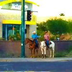 On horseback at the crosswalk