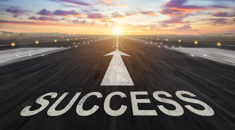 runway with arrow pointing to success